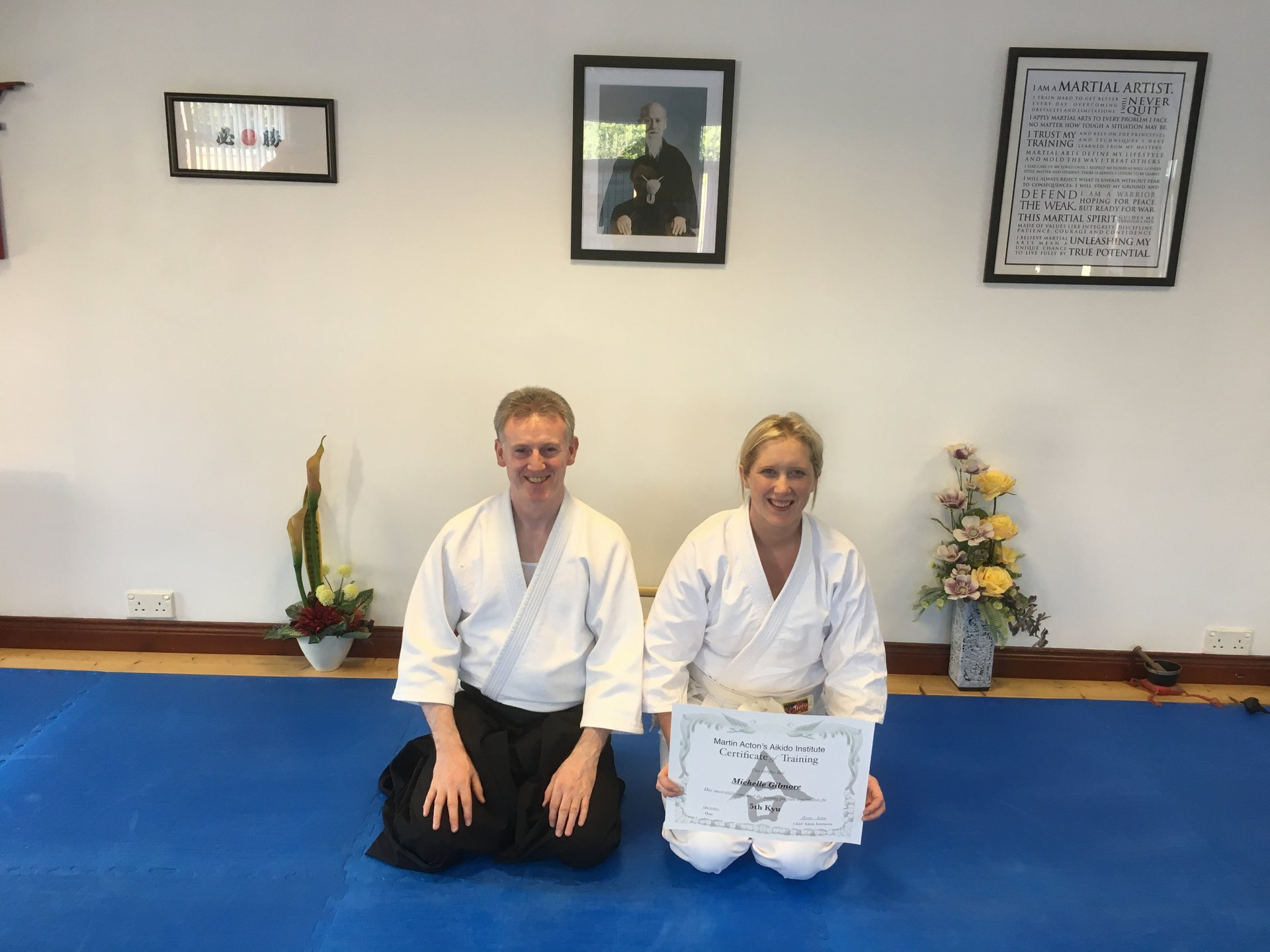 Michelle Gilmore receiving her Aikido 5th kyu certification with Martin Acton sensei