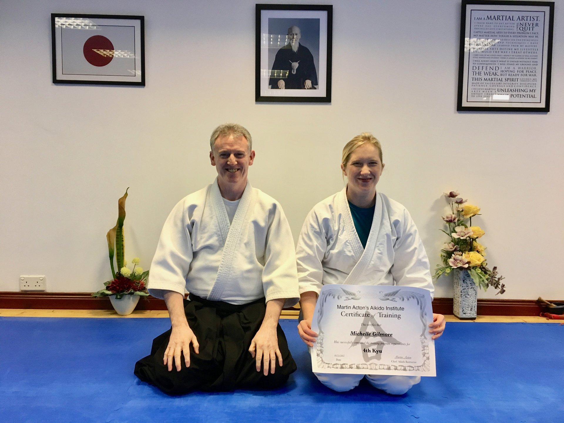 Michelle Gilmore receiving her Aikido 4th kyu certification with Martin Acton Sensei