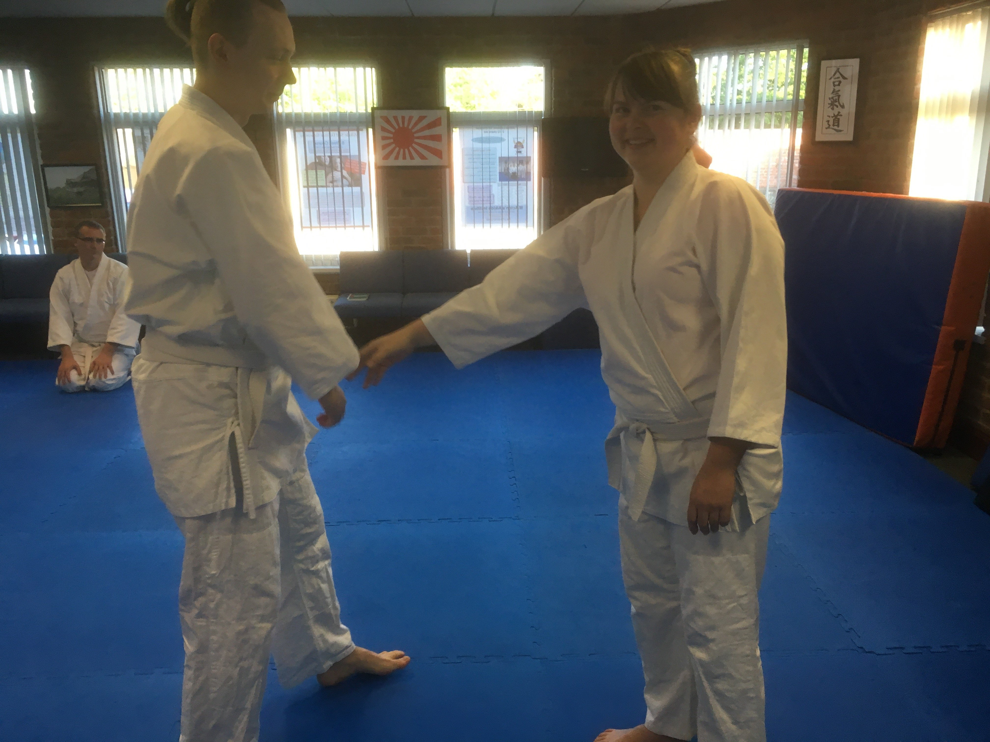 A female student is learning a wrist flick to get an attacker of that grabbed her wrist. Martin Acton's Aikido Institute