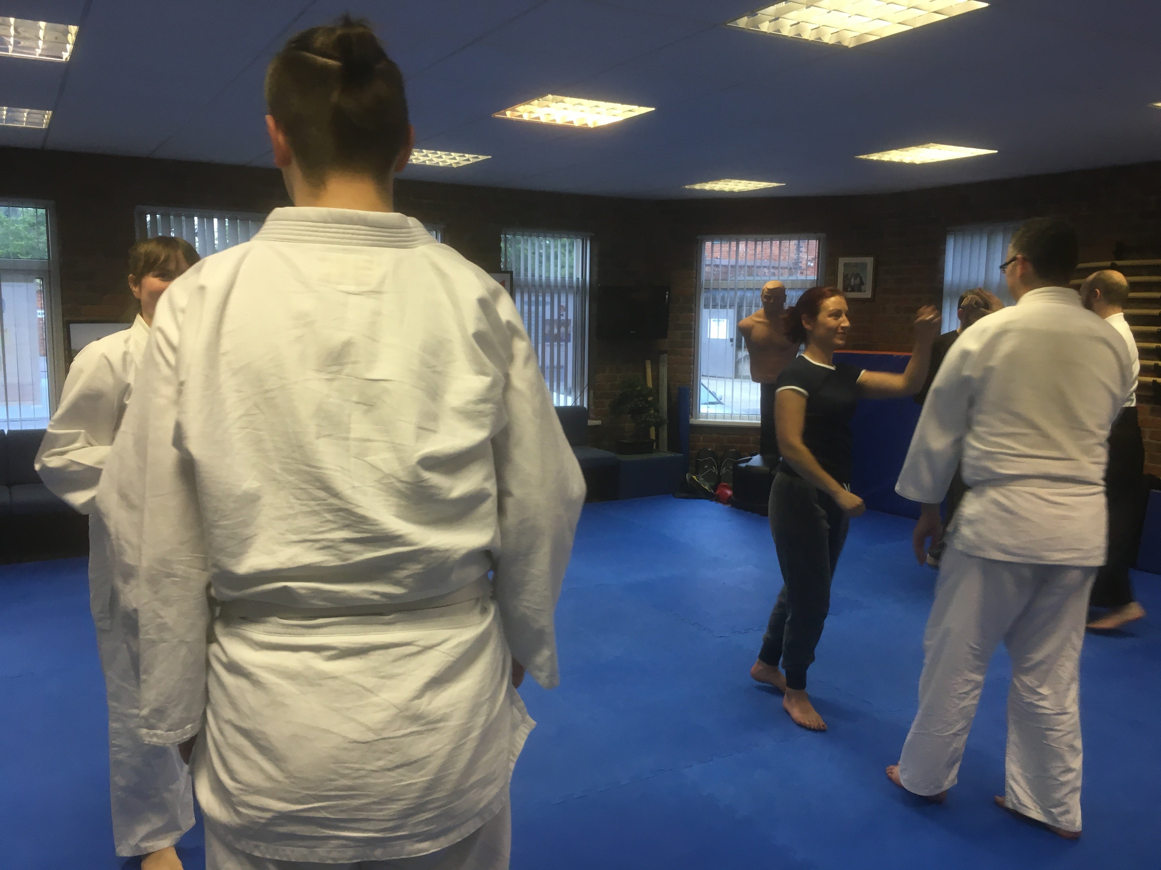 Class of students practicing self-defence