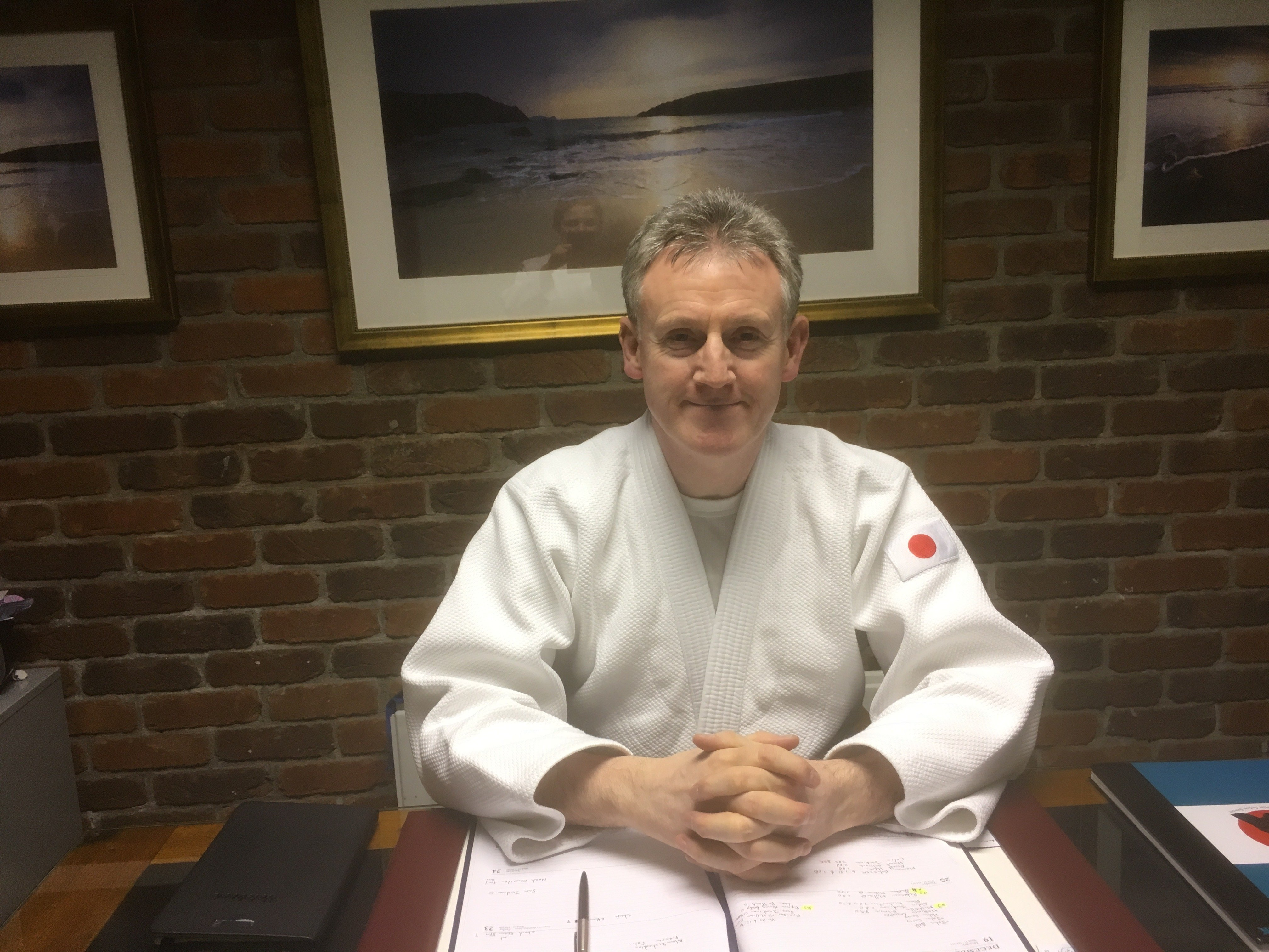 Martin Acton sensei sitting at his desk. Martin Acton's Aikido Institute