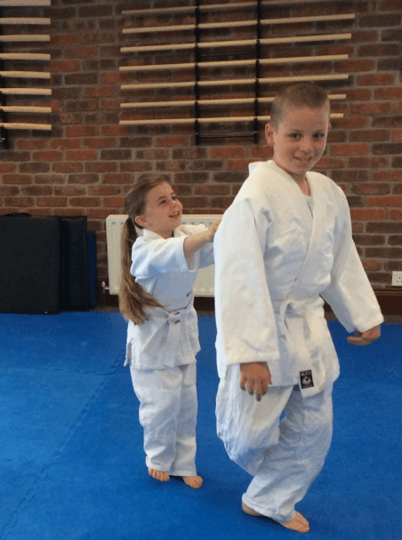 Two children practicing aikido