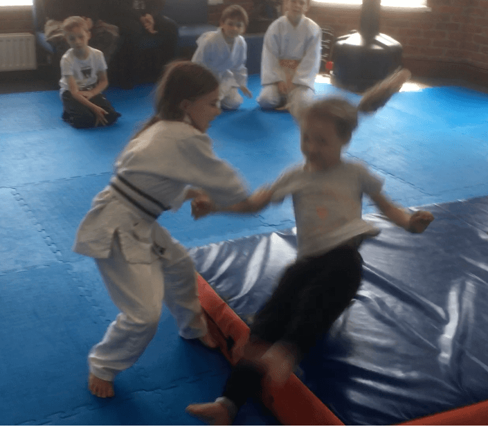 Small children practicing aikido