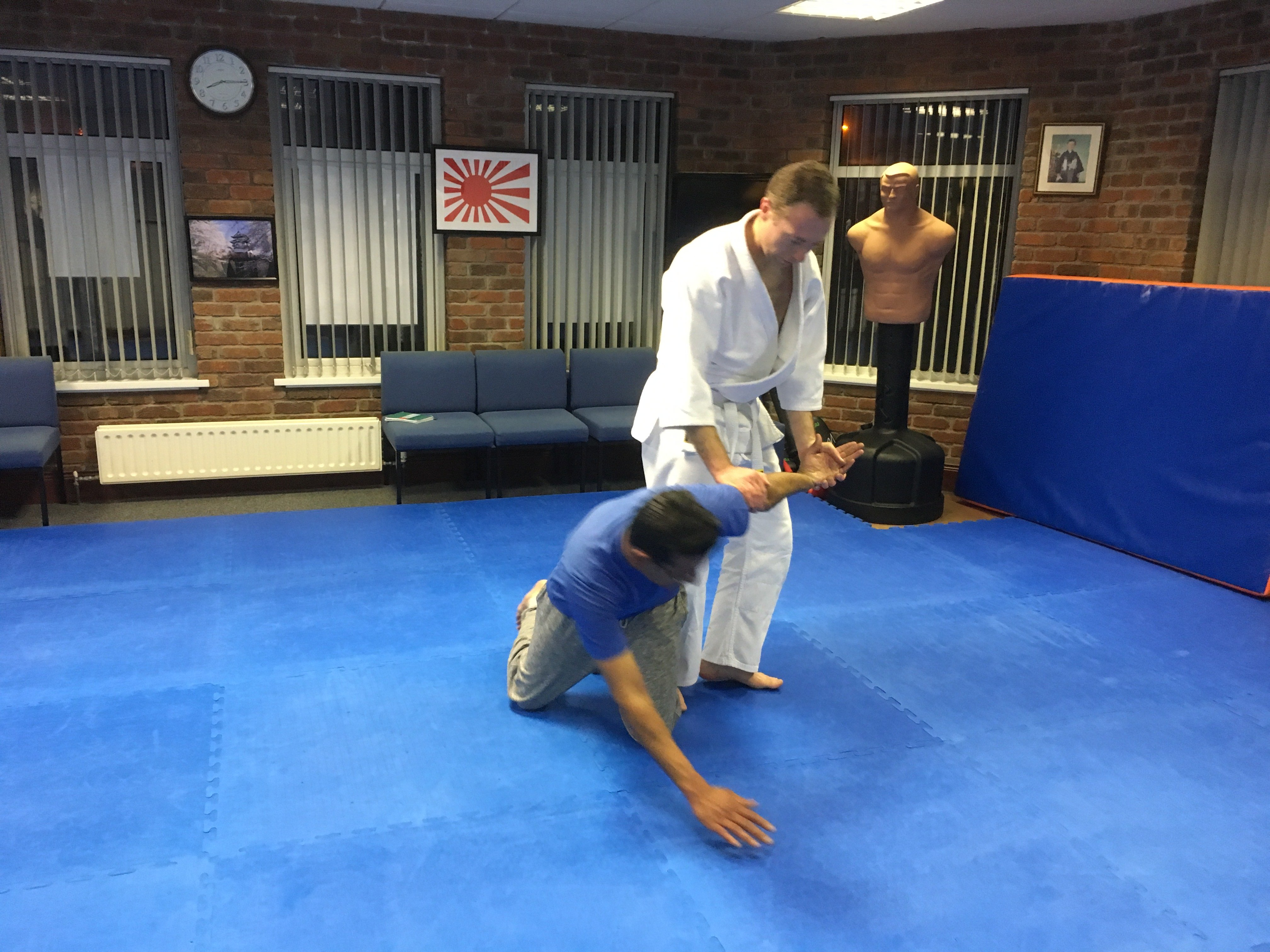 Aikido students learning to lead an attacker into a pin. Martin Acton's Aikido Institute