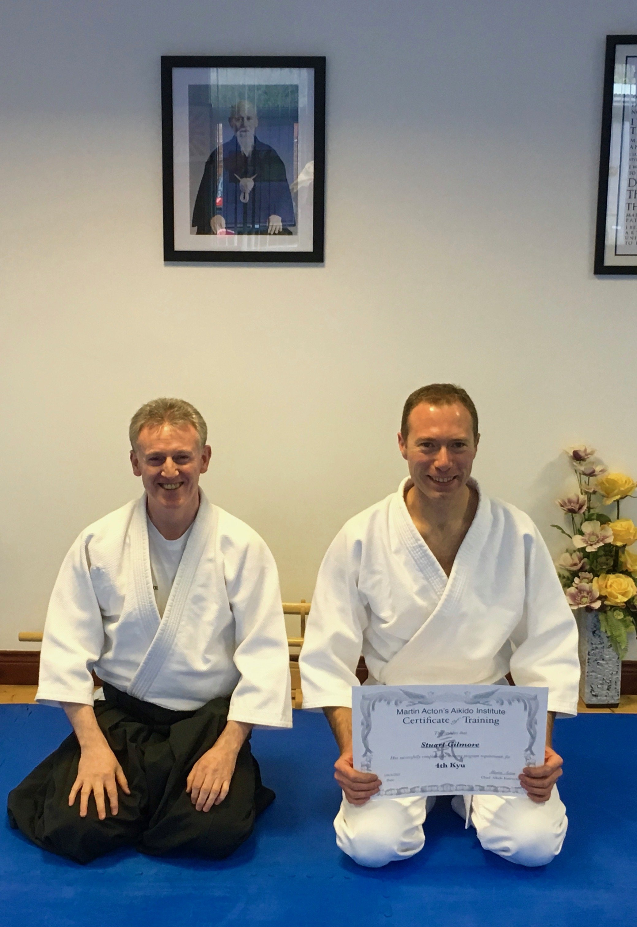 stuart Gilmore receiving his Aikido 4th kyung certification