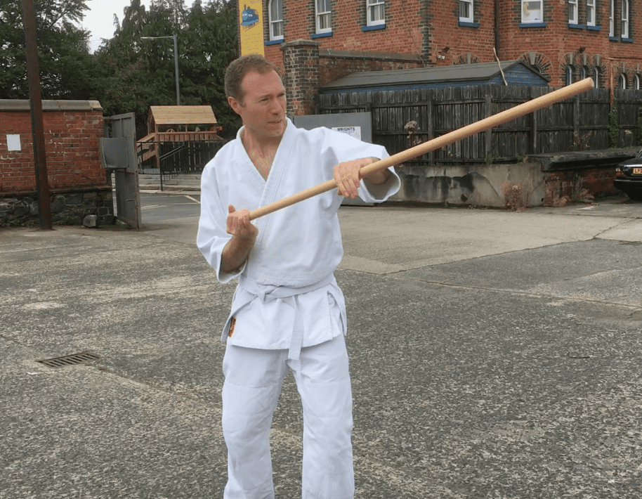 Stuart Gilmore practicing how to strike the head with the staff