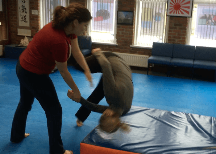 Gillian doing a technique  throwing Michell on to a crash mat.