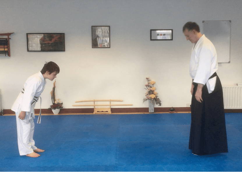 Teacher and student bowing