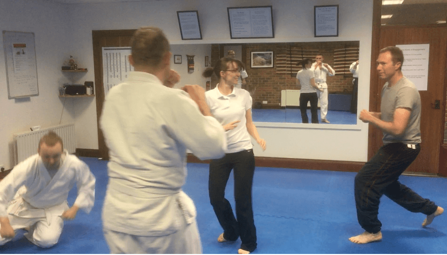 Class of adults learning aikido