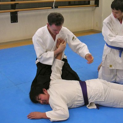 Applying an Aikido pin to restrain an attacker. Martin Acton's Aikido Institute