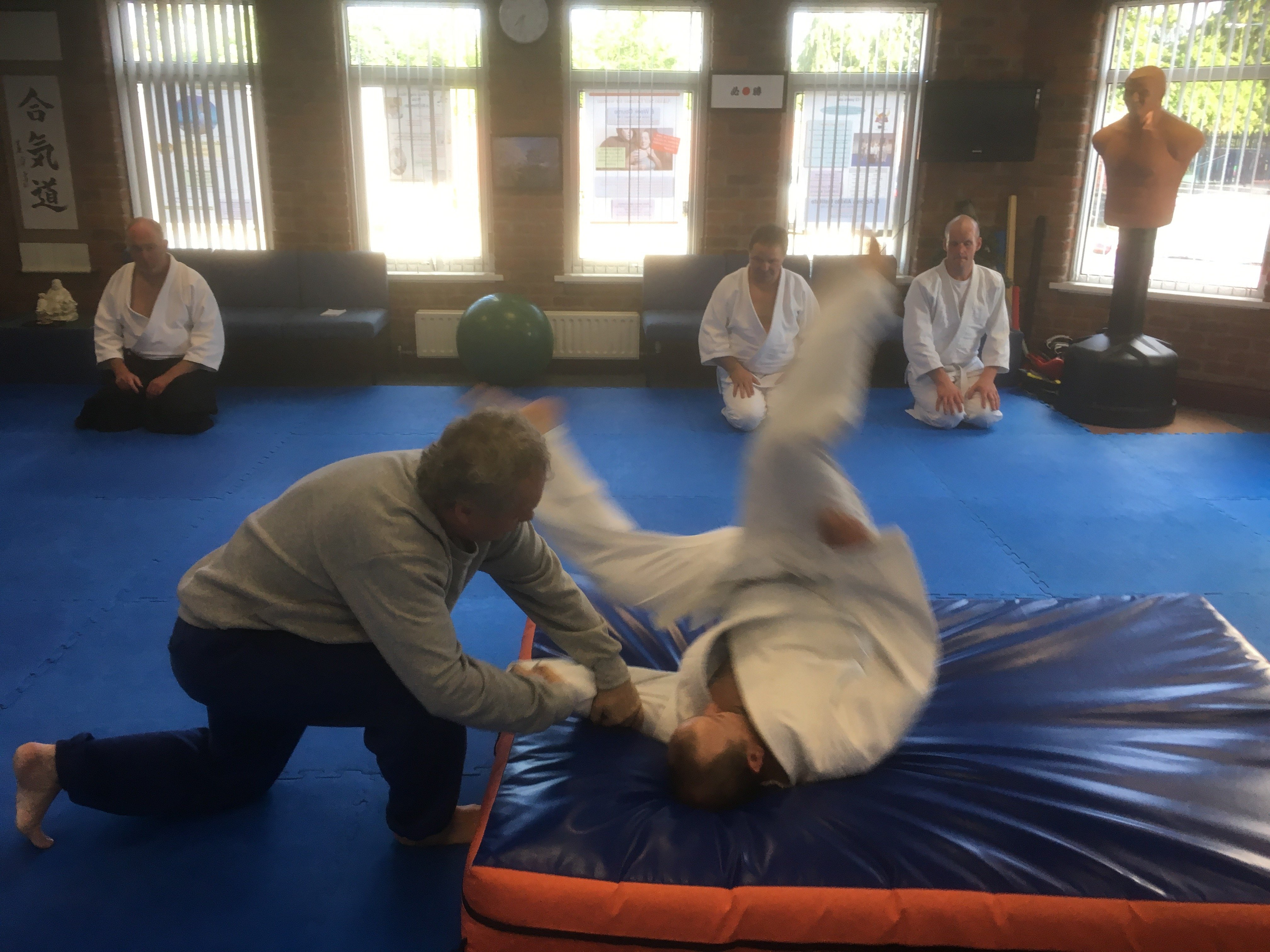 Two students practicing aikido moves