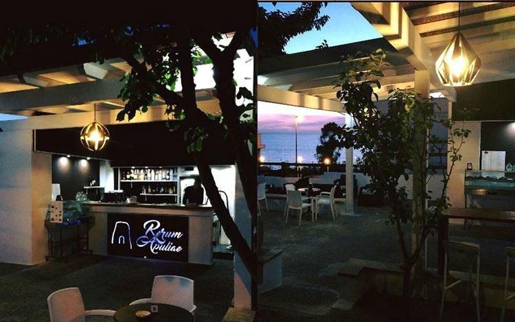 un bar con dei lampadari moderni all'esterno
