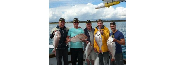 ace fishing charters people with fish
