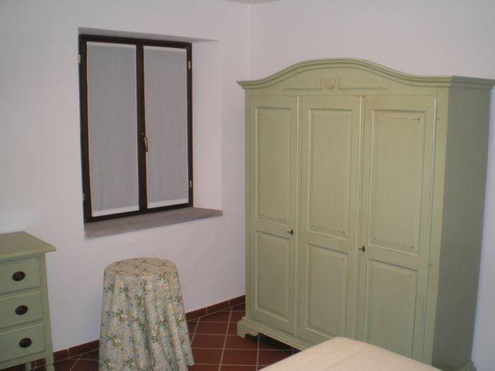 Camera da letto con armadio verde