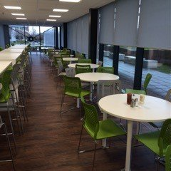 green chairs with white round table