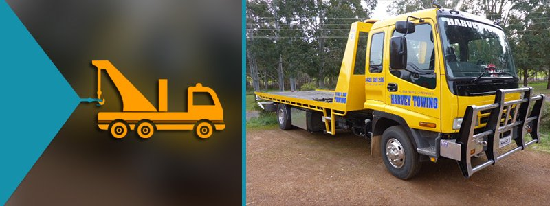 harvey towing services towing truck rightside