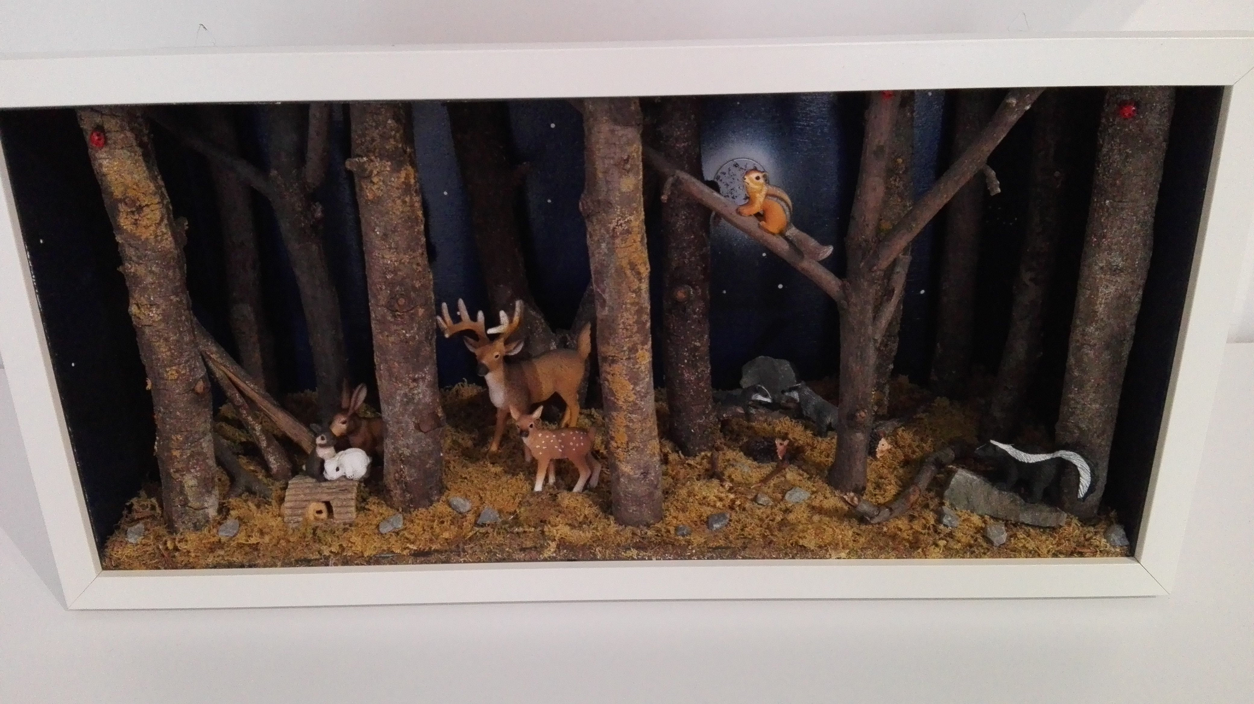 Diorama foresta con cervi