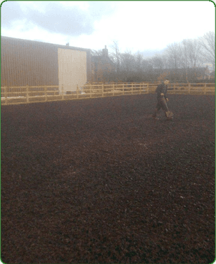 Cleared site with man walking with spade in his hand