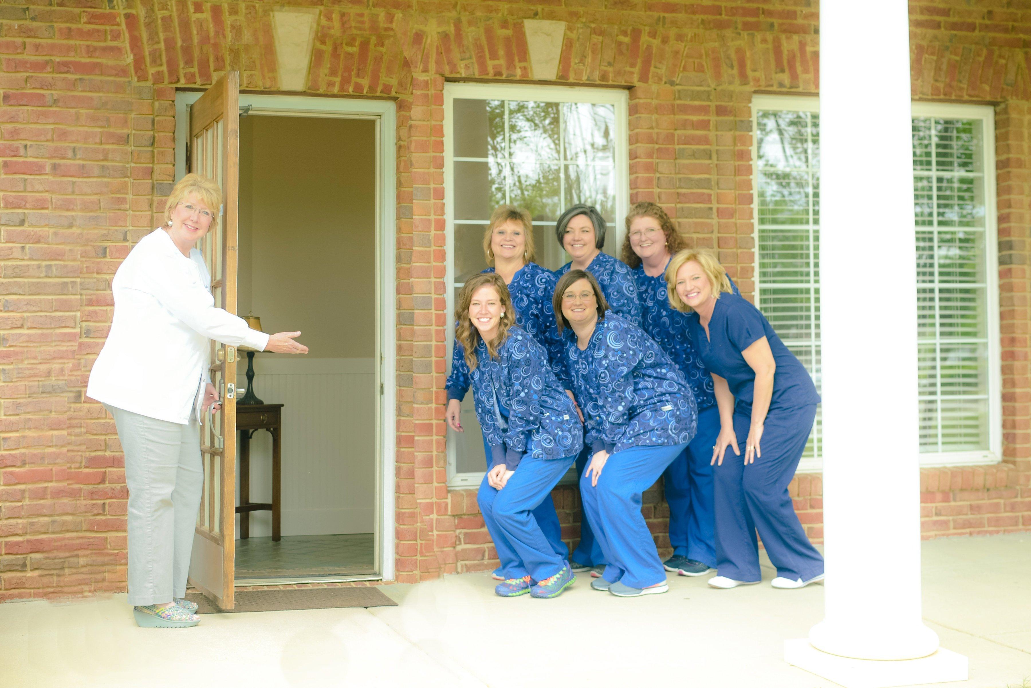 dental staff members smiling for camera