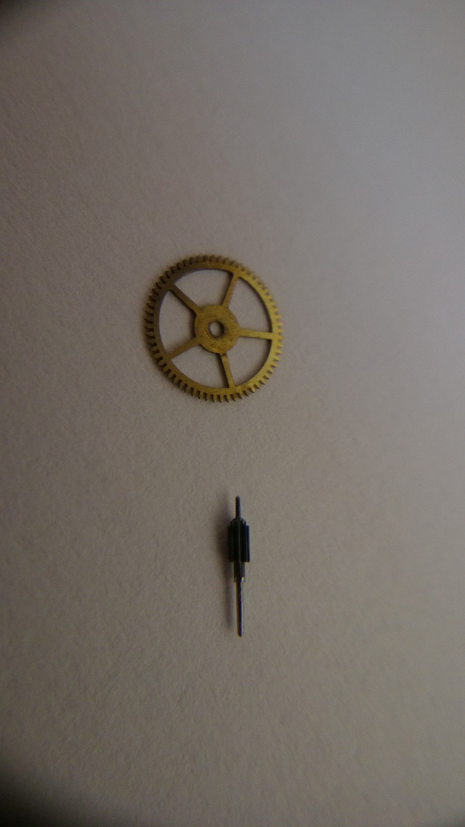 Two parts from inside a watch