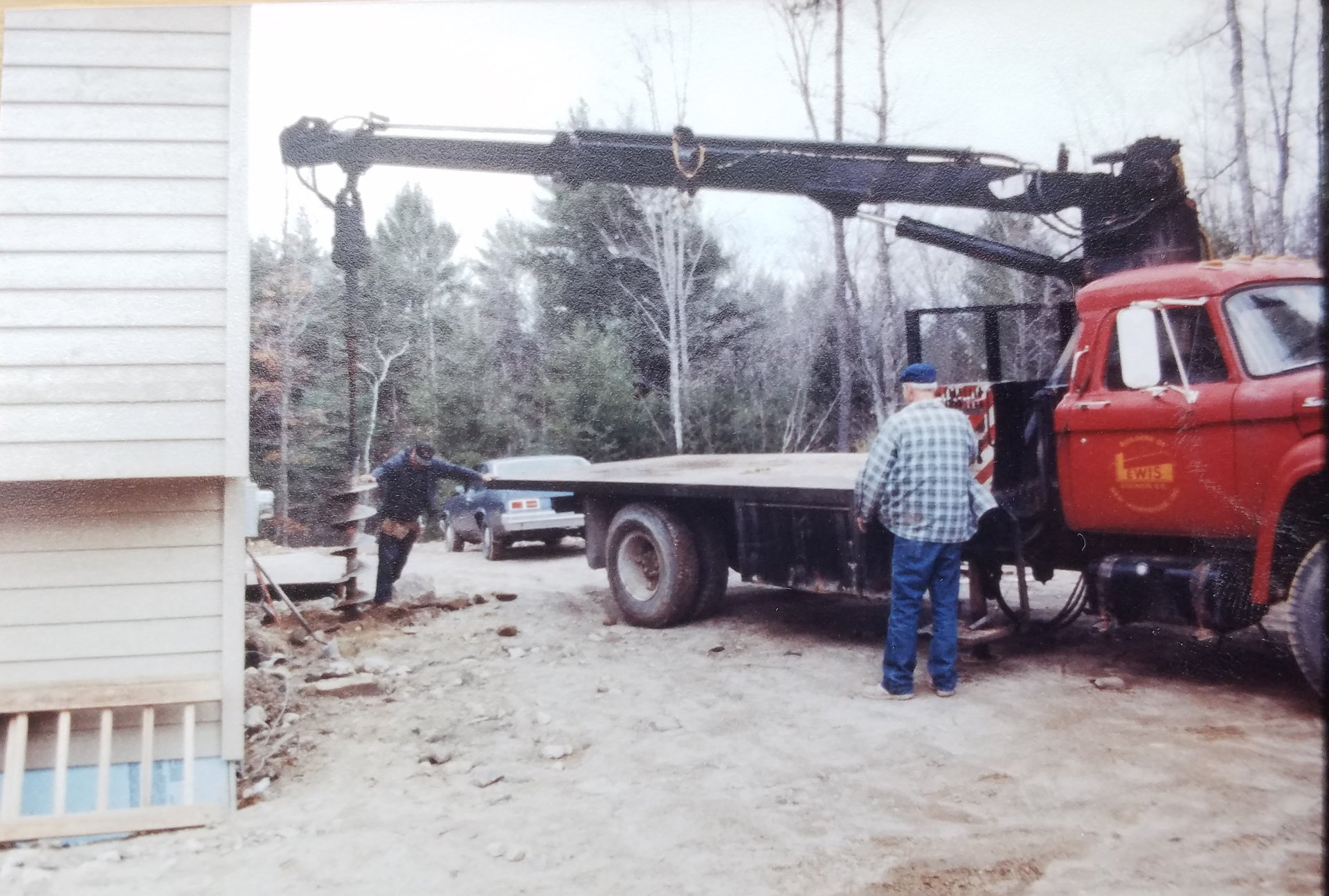 Vintage Lewis Builders truck and workers