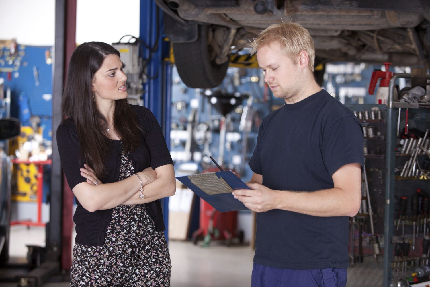 A mechanic answers questions from a client