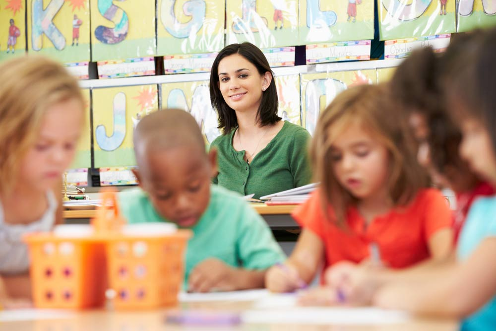 childcare worker watching over children