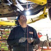 Worker repairs transmission
