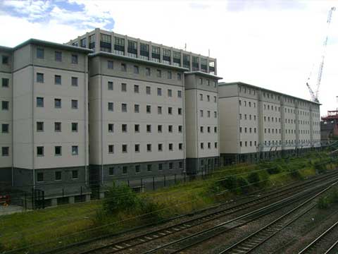 Wide view of a large commercial building with symetrical square windows