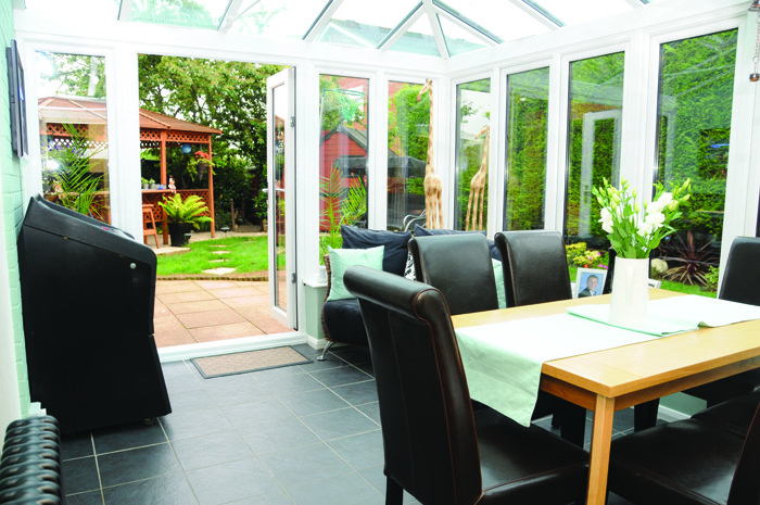 Conservatory with open French doors