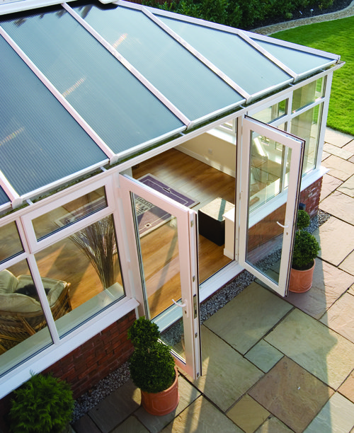 View looking down on a conservatory with open doors