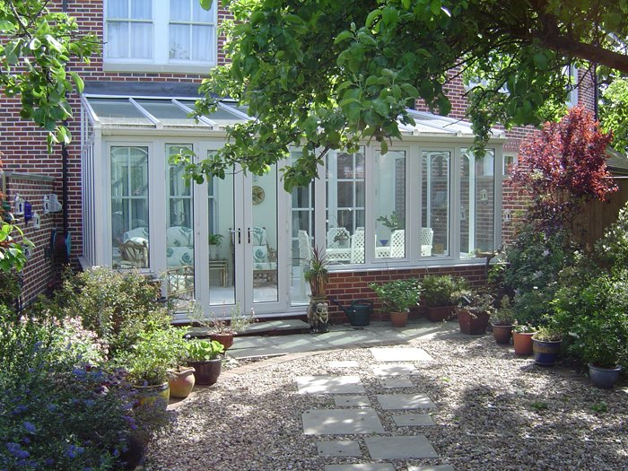 White and glass conservatory on a home