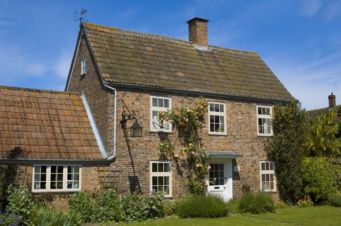 Large rural looking house with double glazing windows