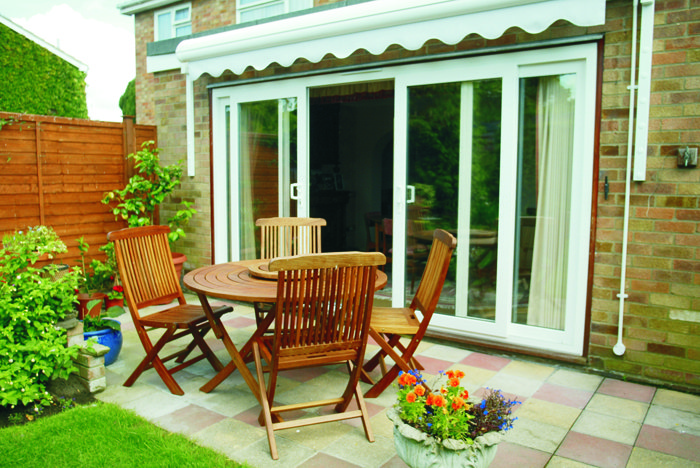 Garden with double glazed open French doors leading to the house