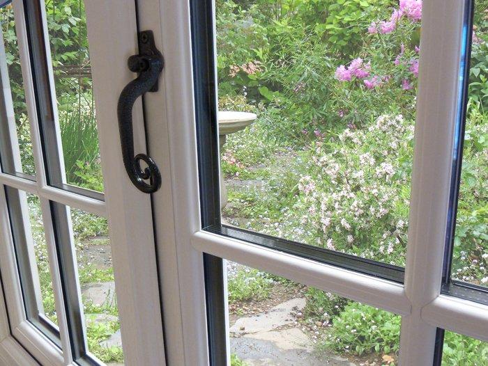 View through a double glazed window into a garden