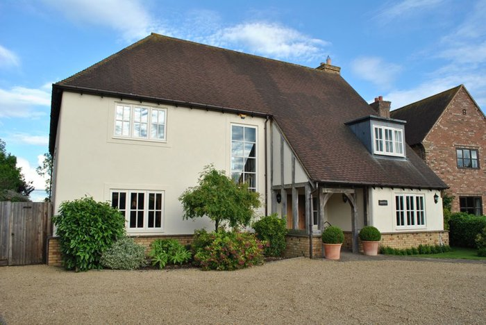 Large home with long timber replacement windows