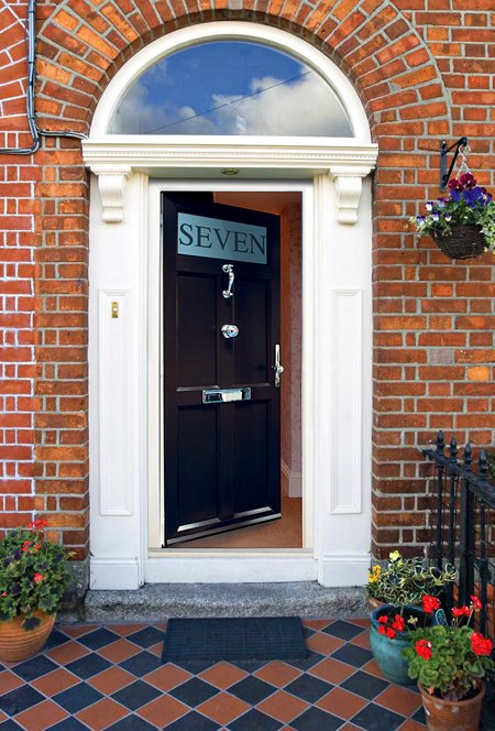 An open front door made of timber replacement products