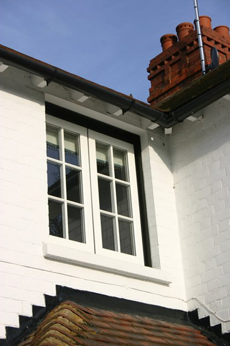 White timber replacement window