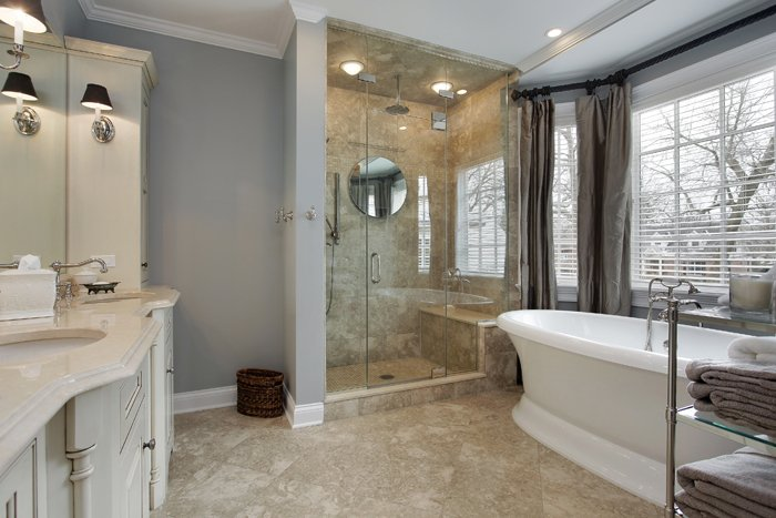 Bathroom with a glass shower curtain