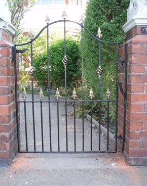 Brown varnished wooden gate from Exclusive Entry Ltd in Macclesfield, Cheshire