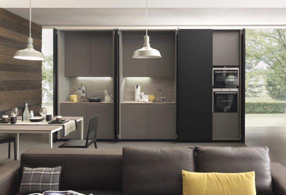 sala da pranzo con cucina moderna con divano, cuscini
