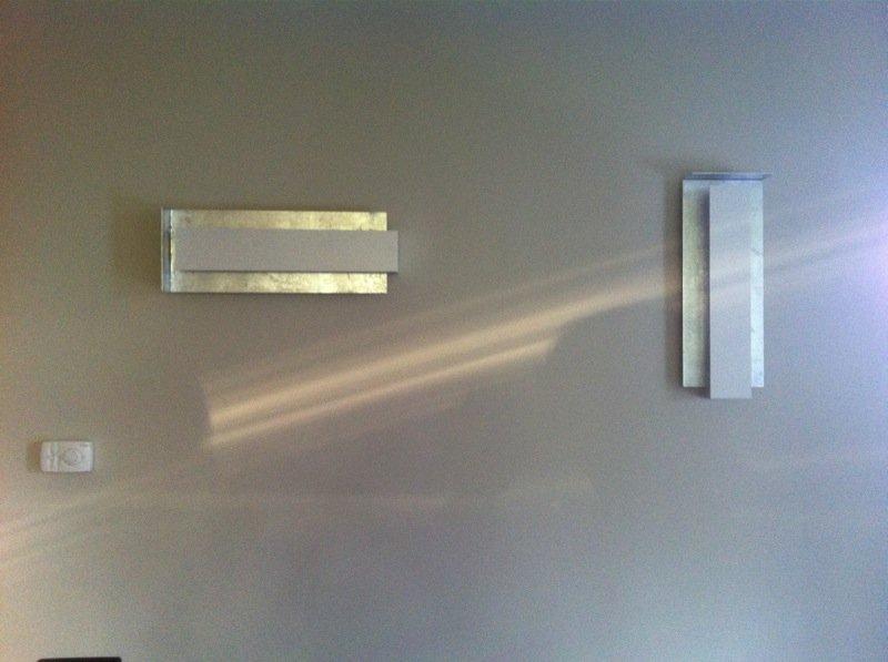 Applique rettangolari bianchi su parete