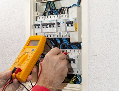 Professional checking the electrical circuit