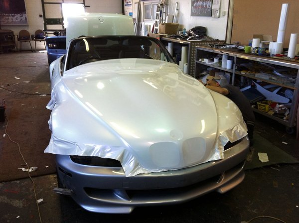 bonnet of a car covered with a white sheet