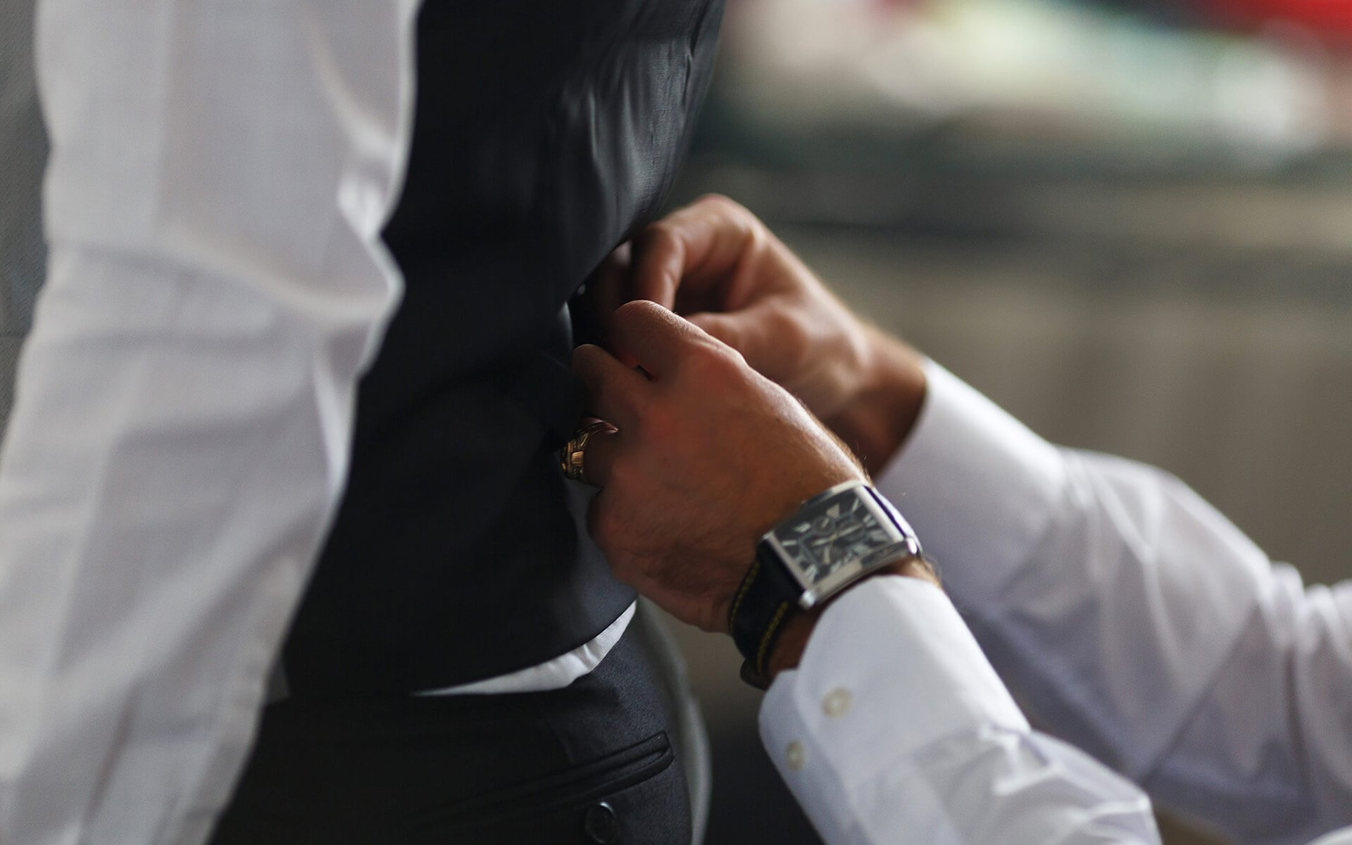 groom putting on cuff-links as he gets dressed in formal wear close up, close up of a hand man how wears white shirt and cufflink, business photo