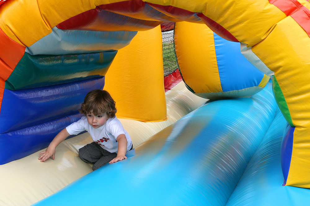 Kid playing in a rented fun bounce house in Greenville, AL