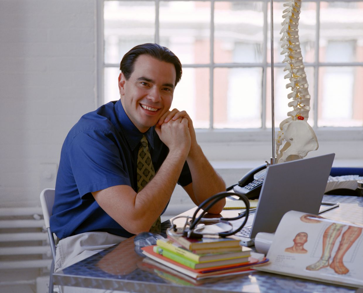 A chiropractor gives a consultation in Juneau, AK