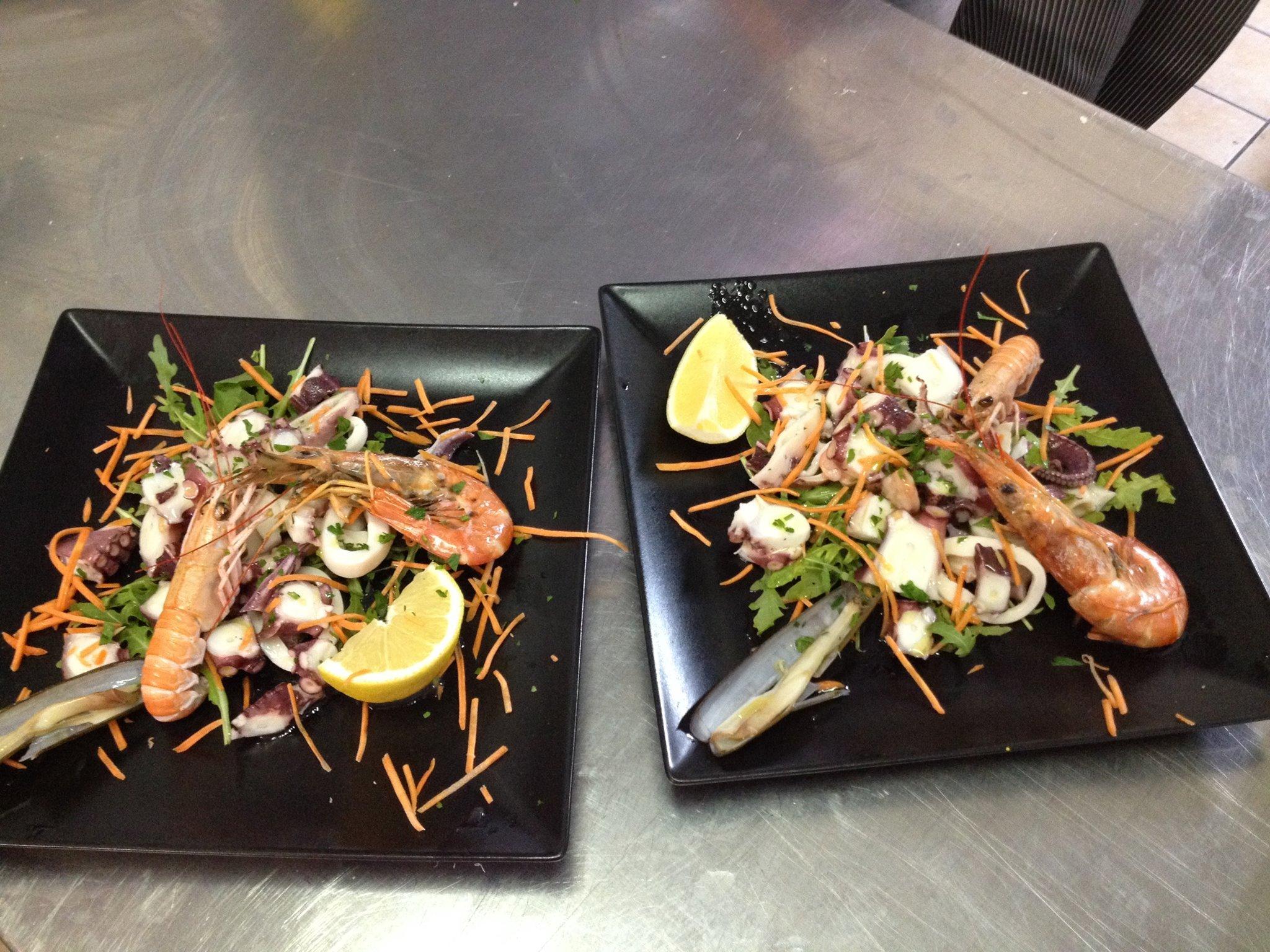 due piatti a base di scampi,polipo e insalata