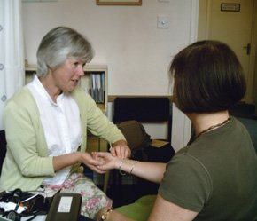 Caroline Sheldrick MNIMH with patient