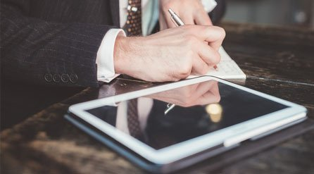 A business person using a tablet
